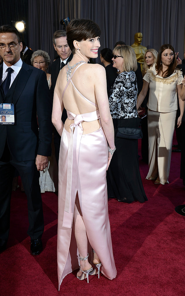 Anne Hathaway showed off the back of her light-pink Prada gown.
