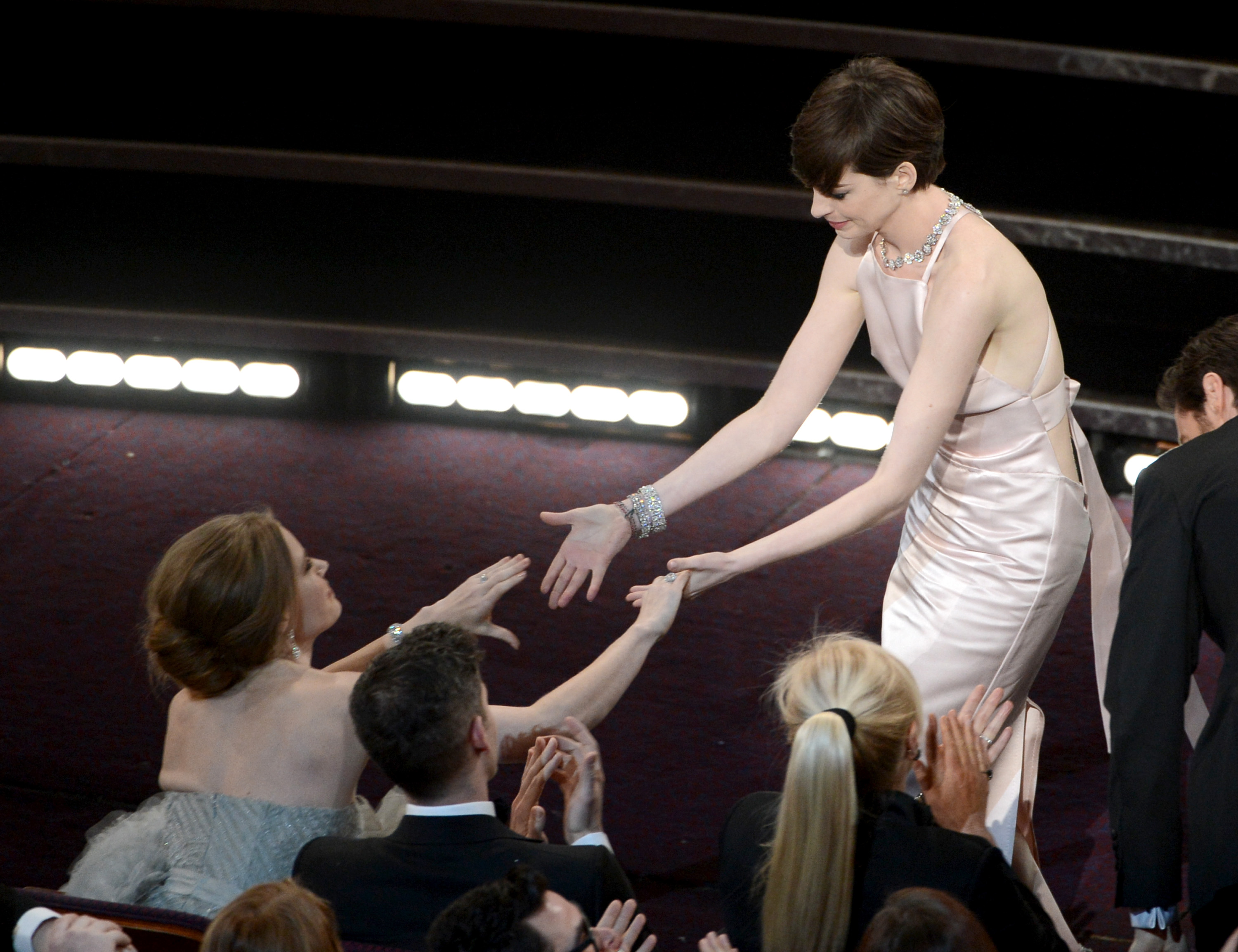 Anne Hathaway and Amy Adams greeted each other.