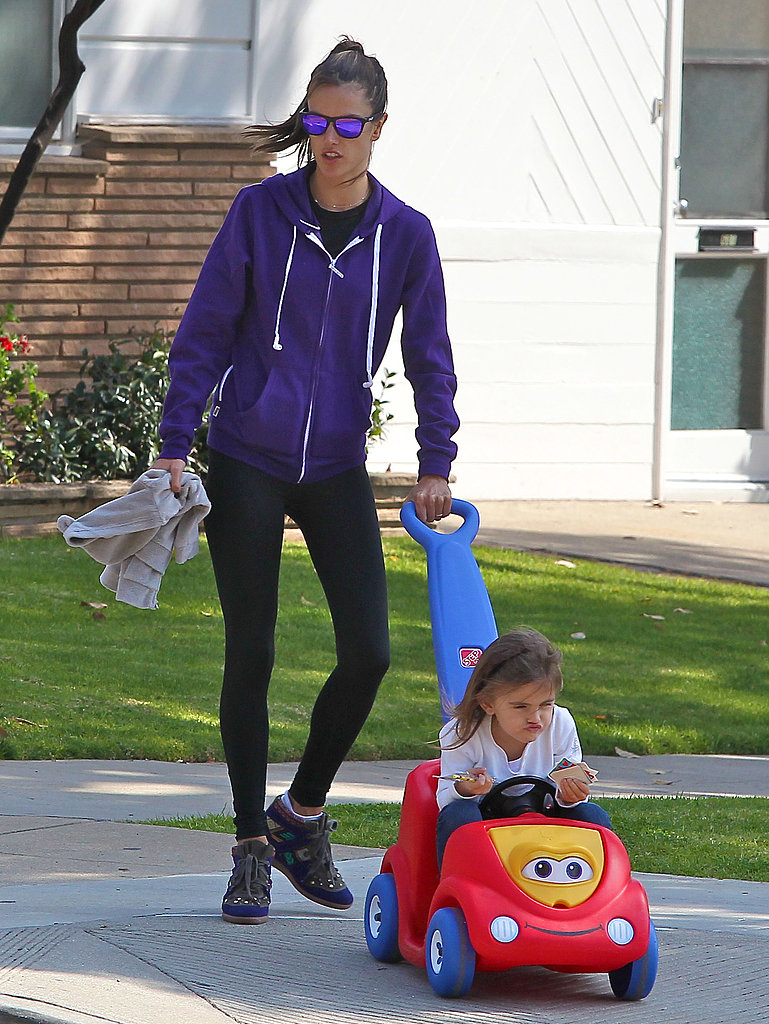 Alessandra Ambrosio pushed 4-year-old daughter Anja in a toy car.