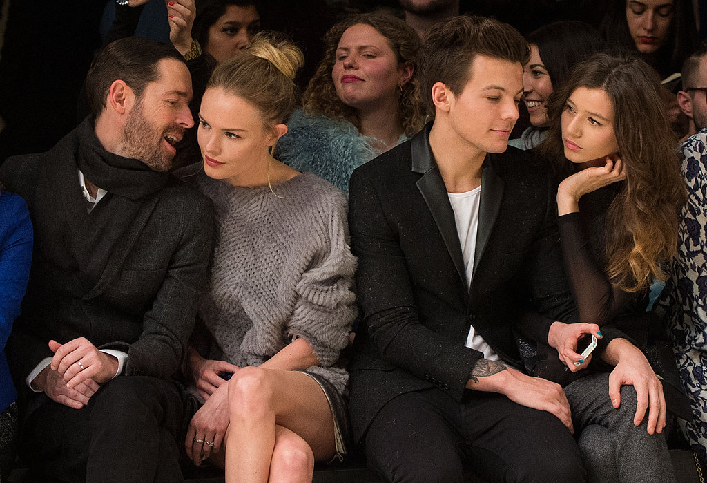 Kate Bosworth snuggled with Michael Polish while sitting next to Louis Tomlinson and Eleanor Calder at Sunday's Topshop Unique Autumn/Winter 2013 fashion show.