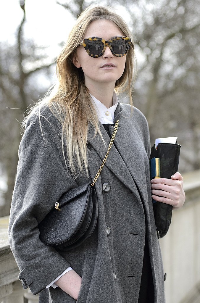 Tortoise sunglasses and a chain-strap bag added interest to a wintry palette.
