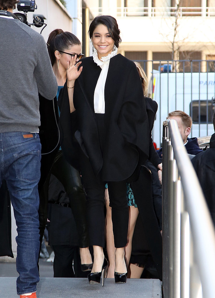 Vanessa Hudgens tapped into her ladylike side in Paris in a ruffle-collar blouse, black collarless coat, cropped pants, and platform pumps.