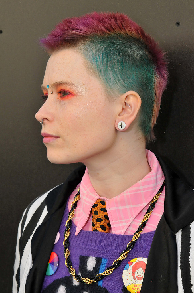 Here's a case for mixing bold hues: this woman paired multicolored hair with fluorescent orange liner.