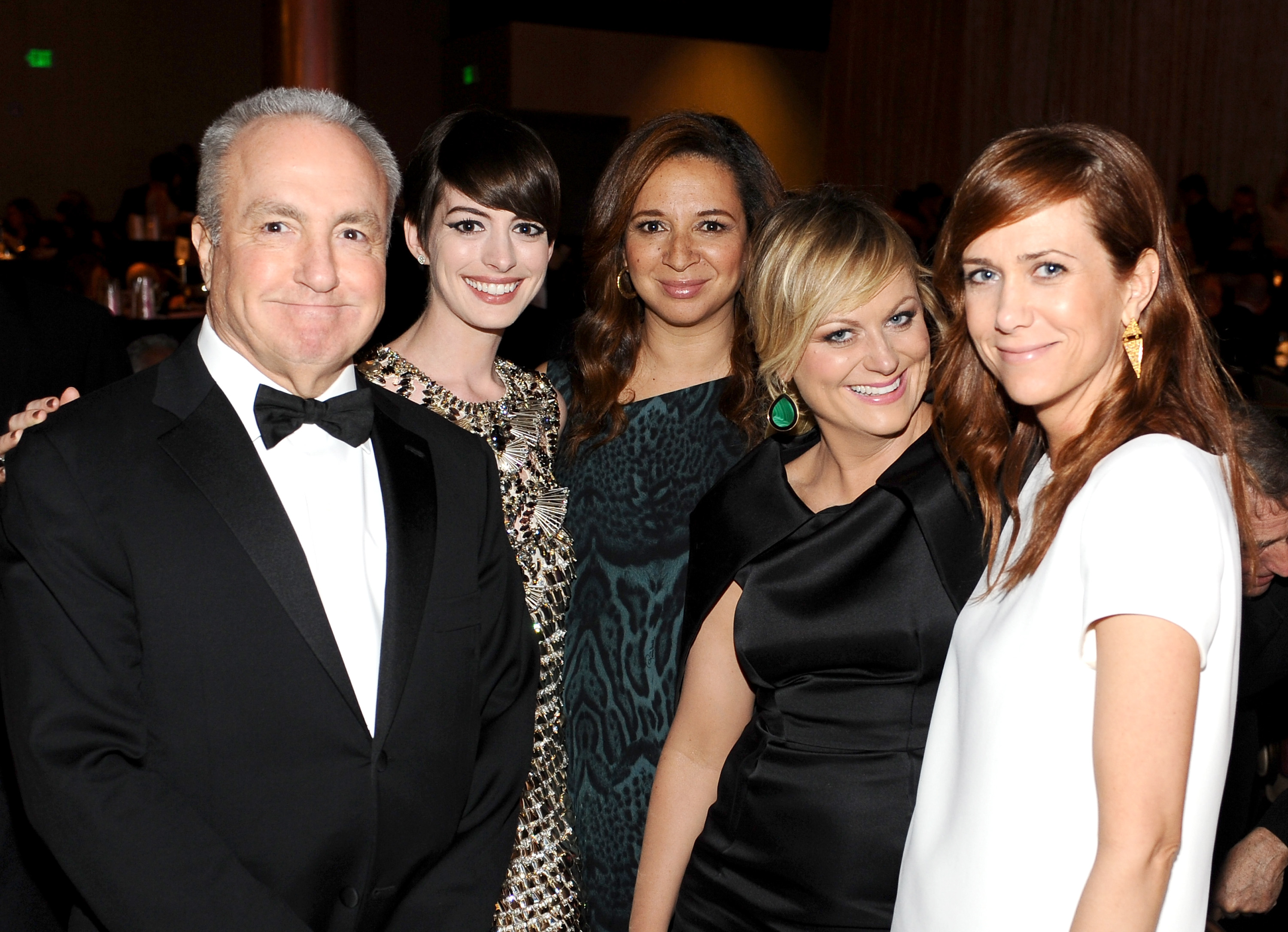 Lorne Michaels, Anne Hathaway, Maya Rudolph, Amy Poehler, and Kristen Wiig posed together during the award show.