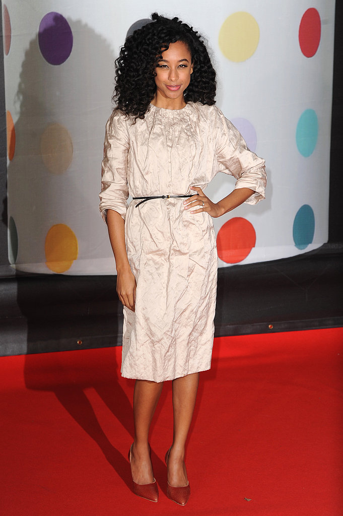 Corinne Bailey Rae styled her crinkly off-white Miu Miu dress with a skinny black belt and brown pointy pumps.