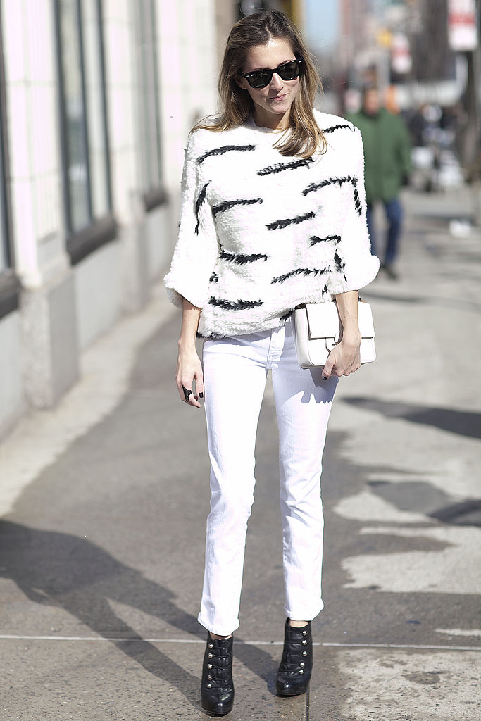 A modern take on zebra print tied together the contrast between her white denim and black booties.