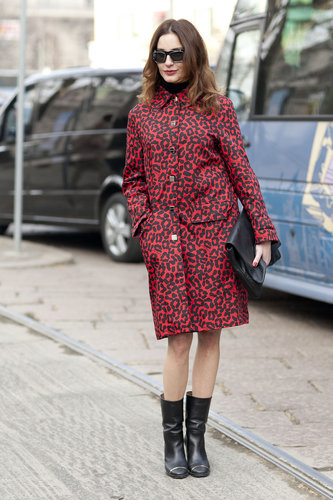A leopard-print coat had just the right amount of print to dress up this attendee's black accoutrements. Source: Le 21ème   Adam Katz Sinding