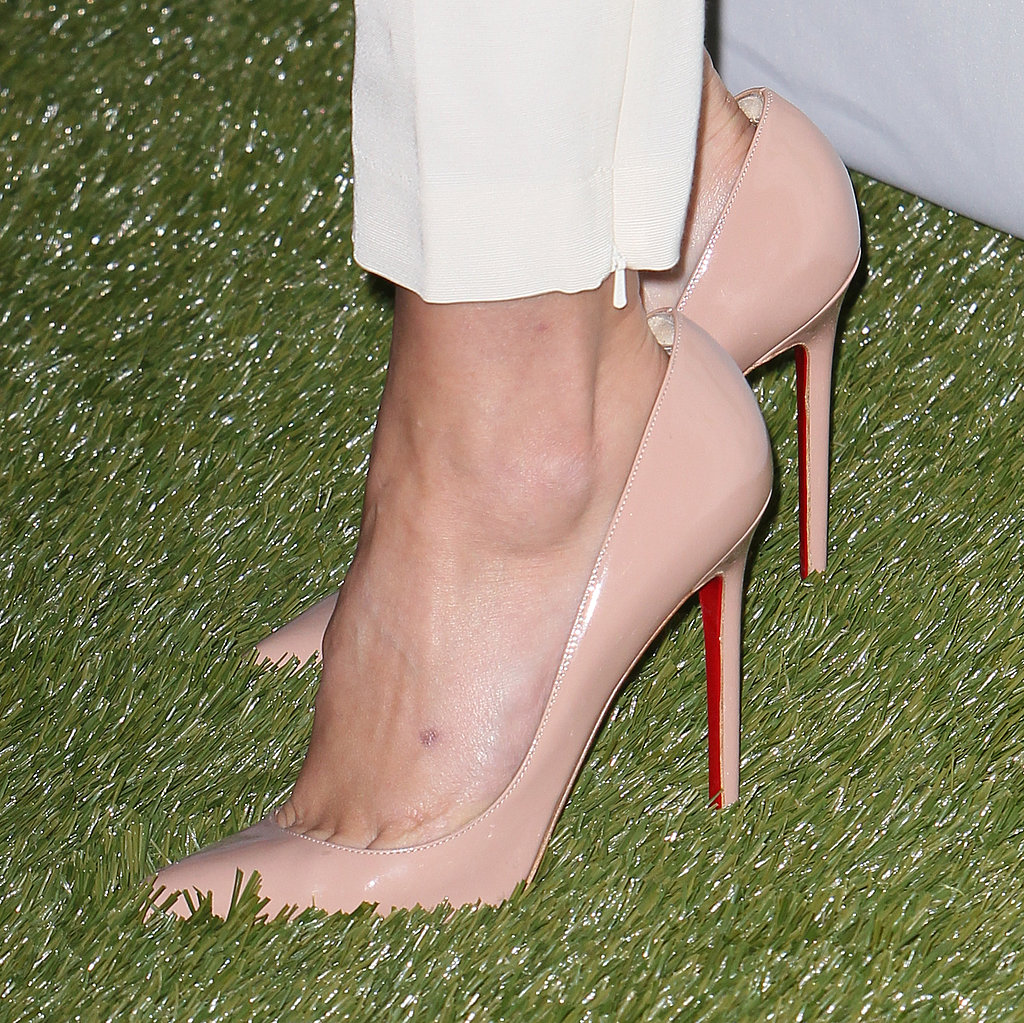 Nude Christian Louboutin pumps completed Sophia's modern getup.