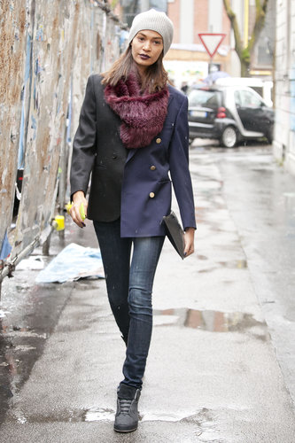 Joan Smalls kept it understated and impeccably cool in a military-style blazer, beanie, and sneakers.