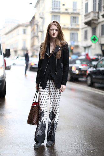 With a moto jacket, this showgoer edged up her Zara pajama-style pants.