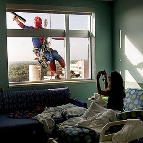 Superheroes surprise kids in children's hospitals