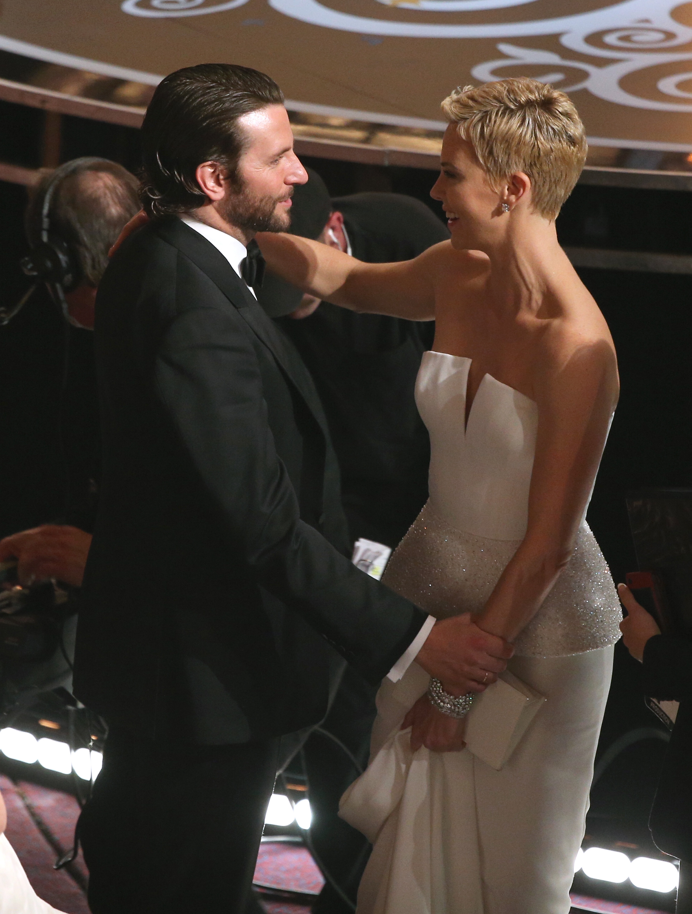 Bradley Cooper and Charlize Theron hugged in the audience.