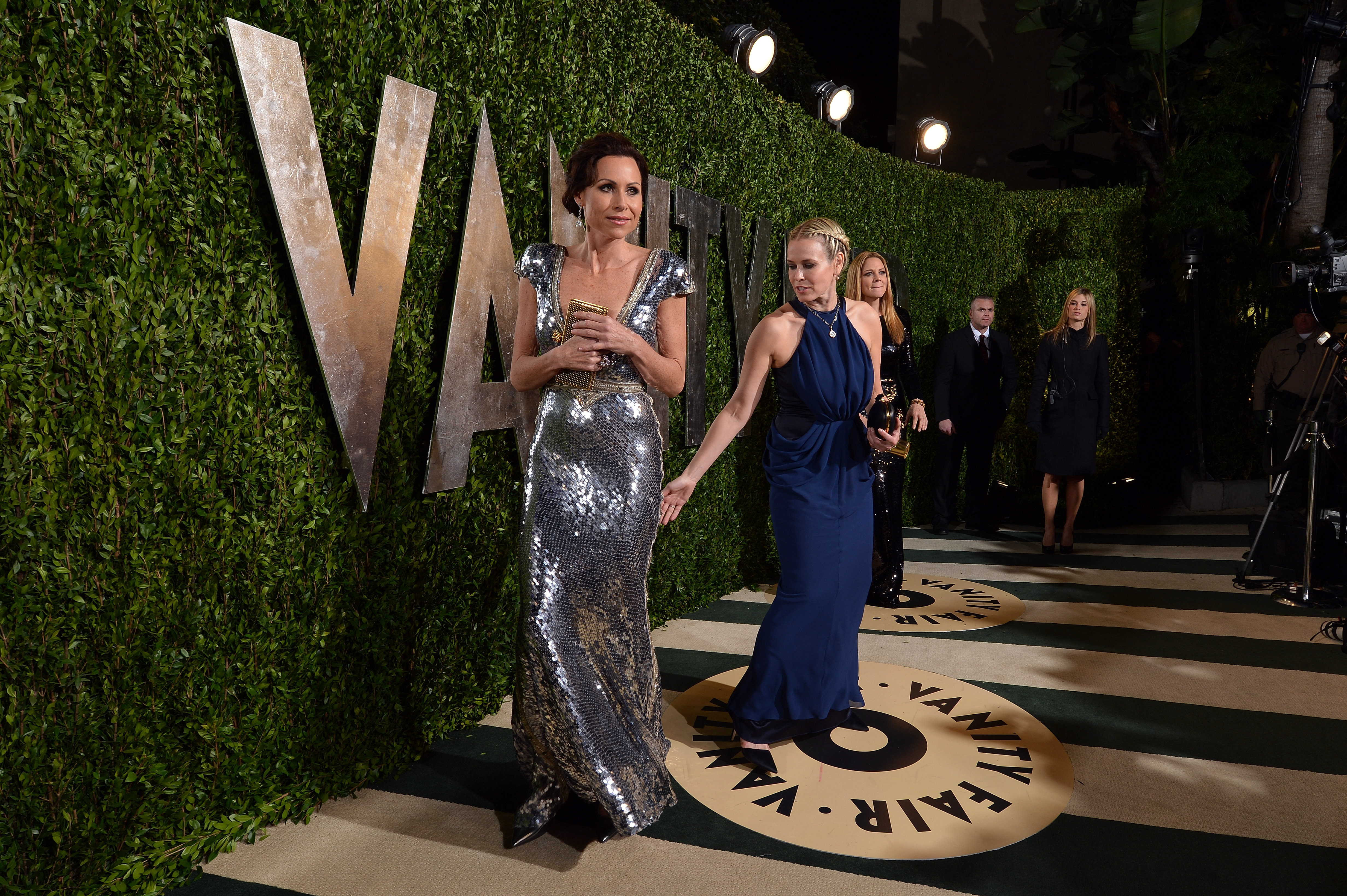 Chelsea Handler gestured toward Minnie Driver's pretty gown on the carpet at the Vanity Fair party.