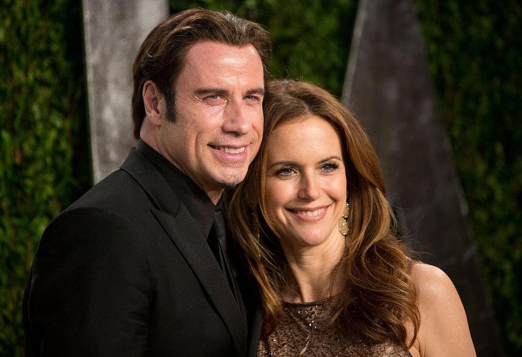 John Travolta smiled with Kelly Preston.