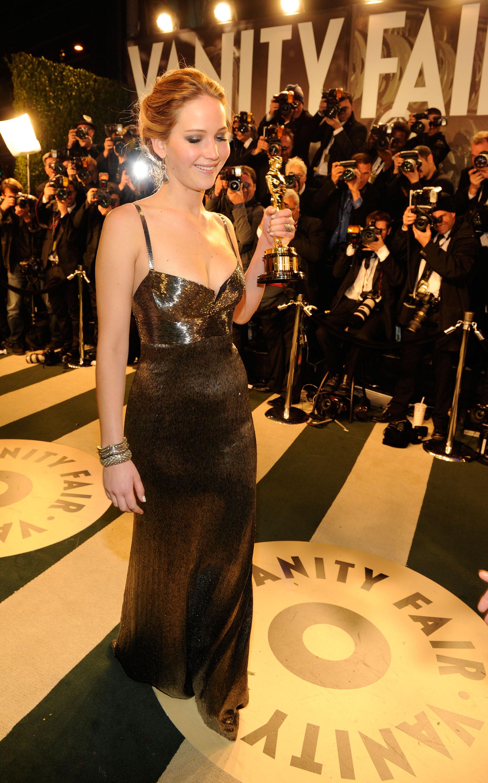 Jennifer Lawrence carried her Oscar into the Vanity Fair Oscar afterparty.