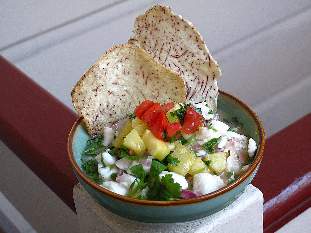 A fresh salsa made with pineapple, tomato, and cilantro gives this Hawaiian ceviche recipe a sweet flavor.