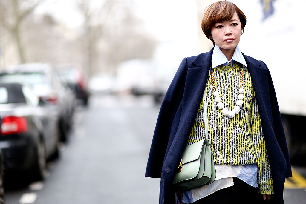 A boyish bowl cut got a touch of femininity with a pearlescent pink lipstick.