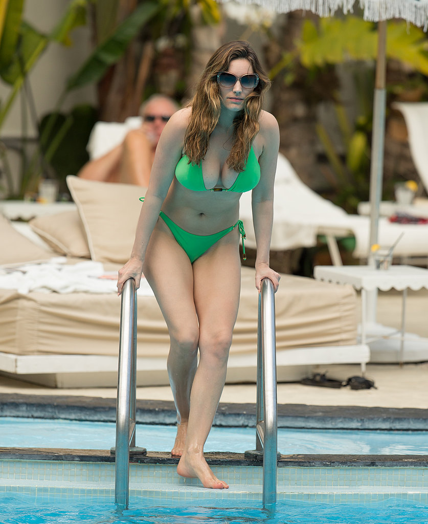 Kelly Brook wore a bright green two-piece at a Miami pool in Feb. 2013.