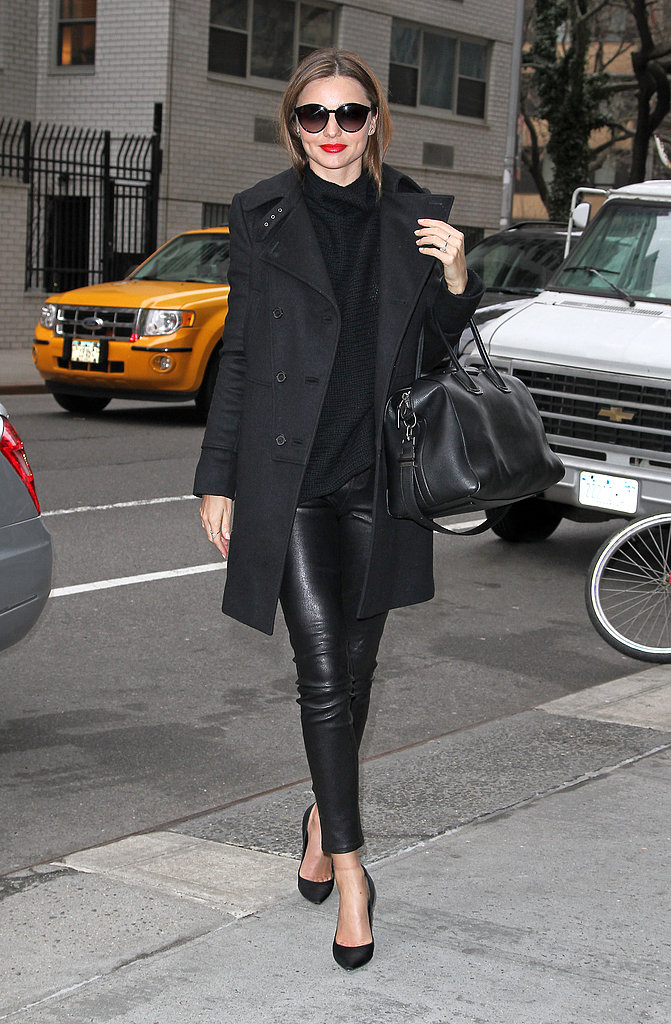 Miranda went all black in cropped leather pants, pointy pumps, a turtleneck sweater, black coat, her trusty Givenchy bag, and round Stella McCartney sunglasses in NYC.