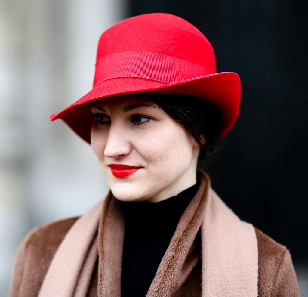 Red lips and a matching hat are the perfect Paris Fashion Week pairing.