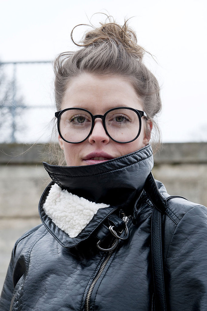 Oversize frames and a tousled bun were all this girl needed to elevate her street-style look.