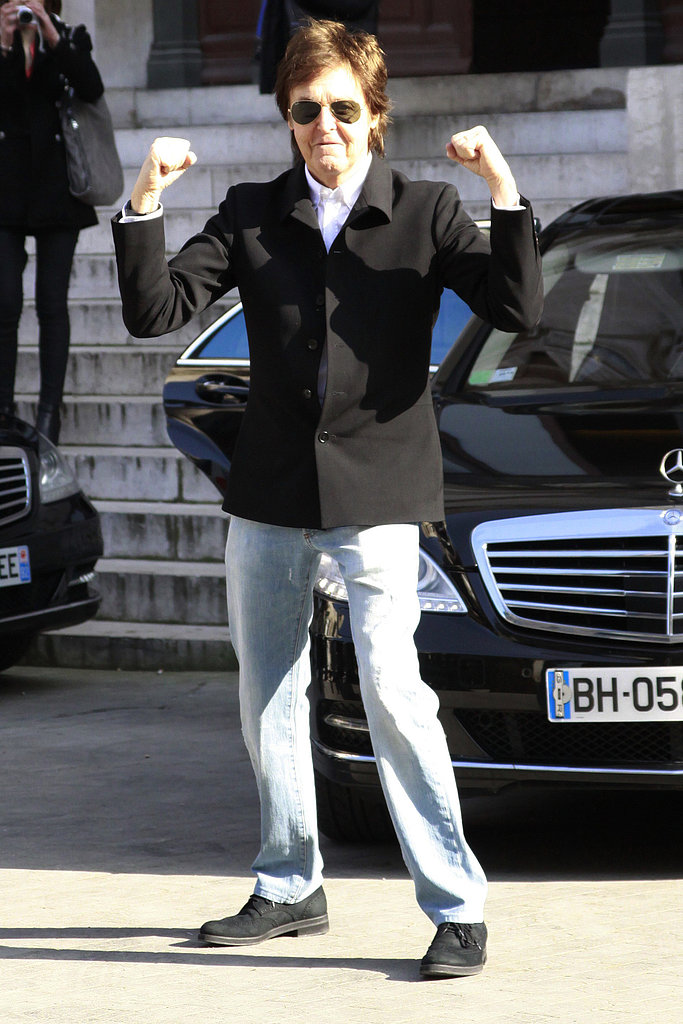 Paul McCartney flexed his muscles while walking into his daughter Stella McCartney's fashion show in Paris in March.