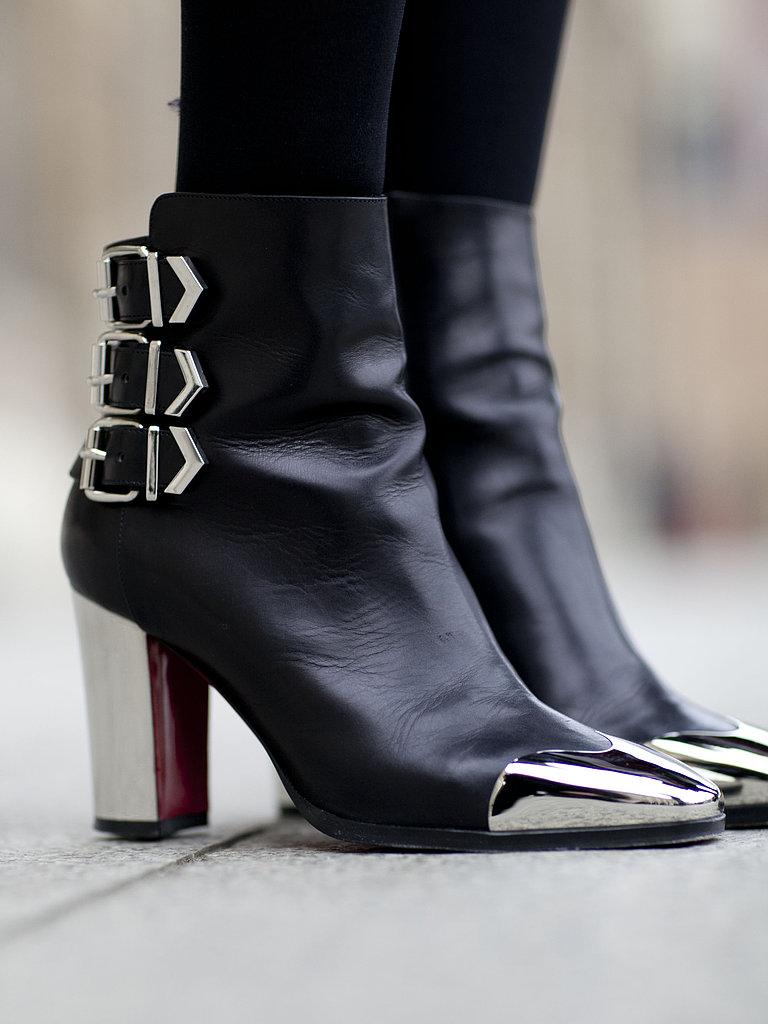 We love the metallic cap-toe details on these Christian Louboutin boots.