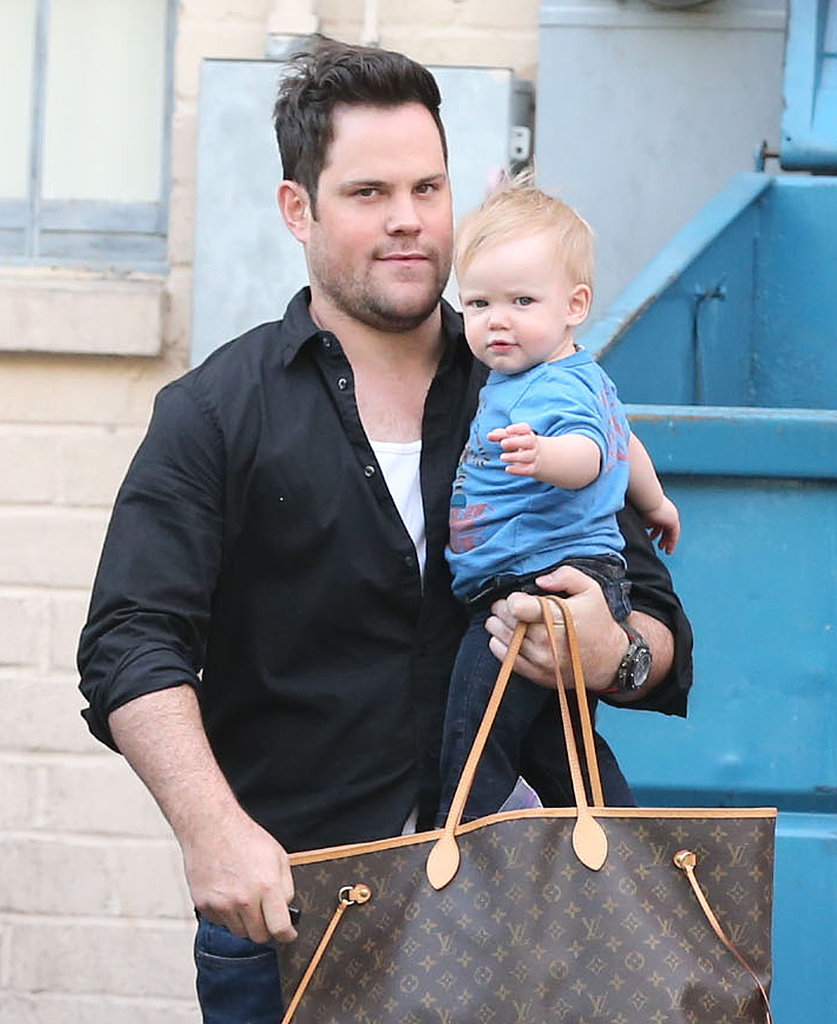 Mike Comrie carried Luca and his wife Hilary Duff's bag around LA on Sunday.