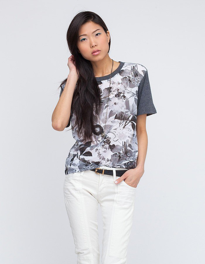 The faded palette makes the florals on this Wood Wood Moa Tee ($100) feel a little more subtle, making it an easy option to throw under a leather jacket right now.