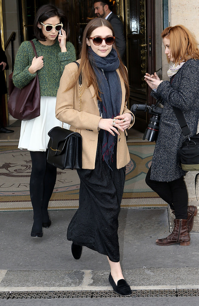 Elizabeth Olsen was spotted outside the shows in a perfectly layered ensemble, including a camel blazer, black maxi skirt, and loafers.