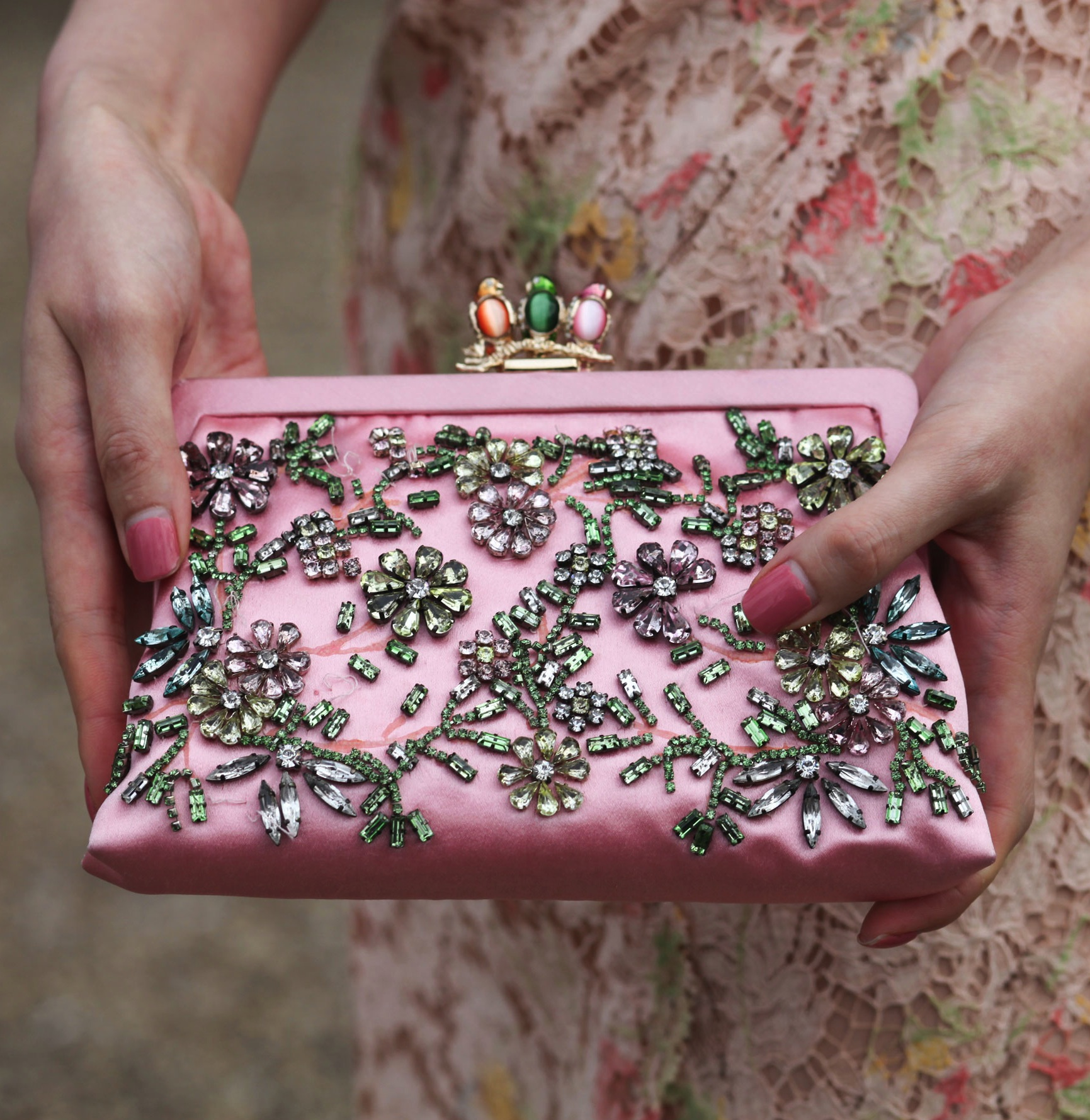 A Fashion Week attendee showed off her intricate, jewel-embellished satin clutch.