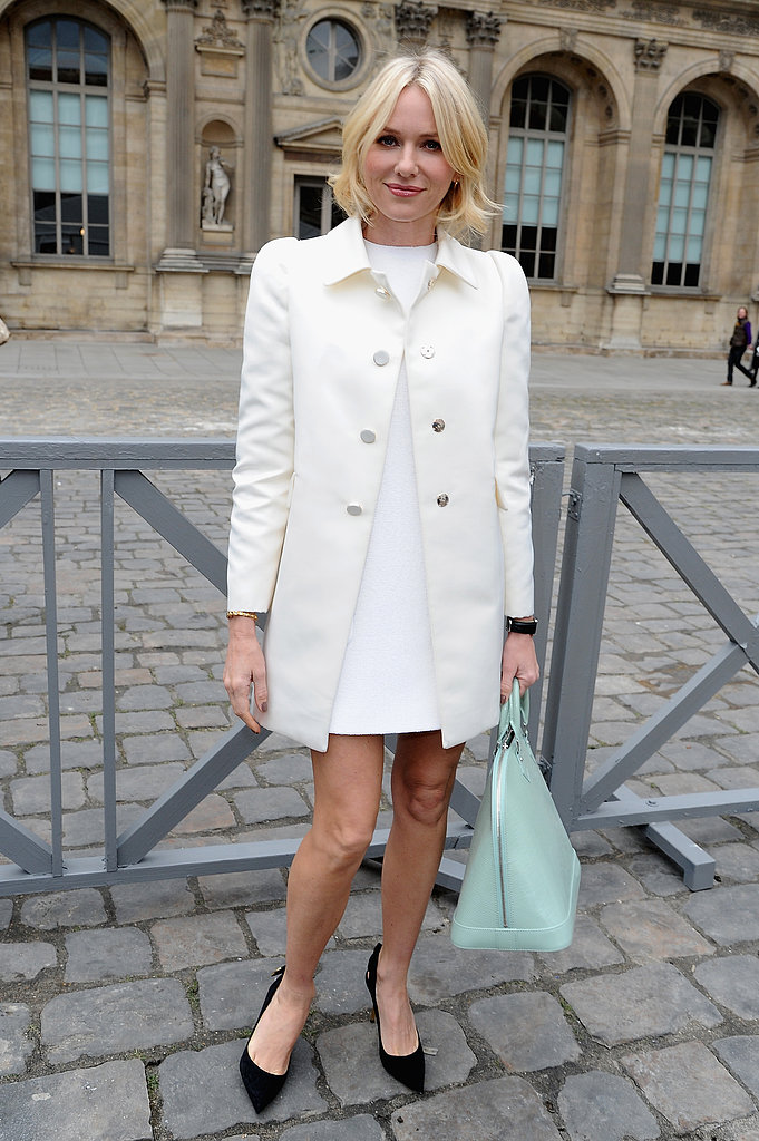 Outside Louis Vuitton's show, Naomi Watts was fresh in a little white dress, off-white coat, black pumps, and a mint-green Louis Vuitton bag.