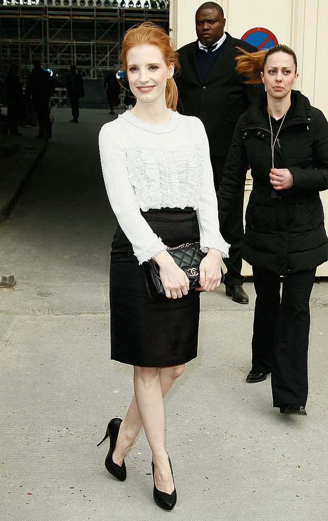 Outside the Chanel show at the Grand Palais, Jessica Chastain stuck to a sophisticated black and white palette. She tucked a white ruffled blouse into a black pencil skirt, then finished with black pumps and a black quilted Chanel bag.