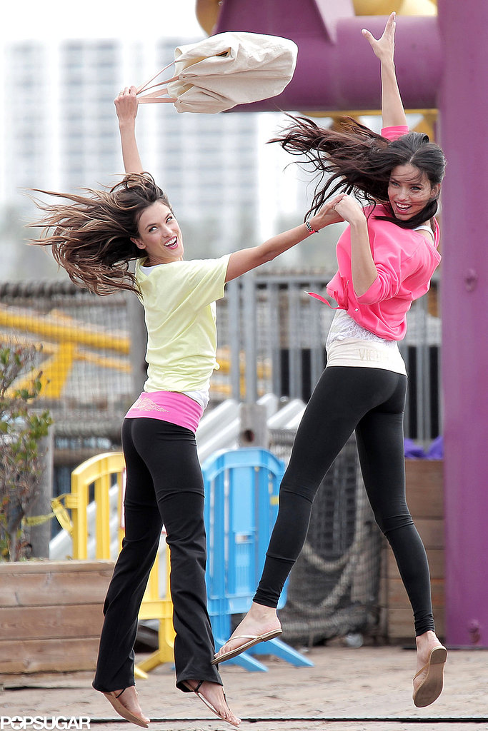Alessandra Ambrosio and Adriana Lima jumped around on the set.