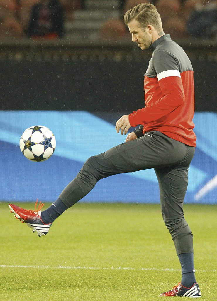 David Beckham kicked around a ball before the game.