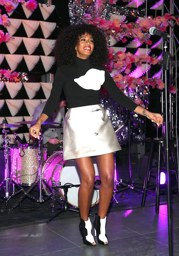 While performing at The Armory Party in NYC, Solange Knowles took her color palette in a mod direction via a metallic miniskirt, black turtleneck with an abstract print, and black and white peep-toe booties.