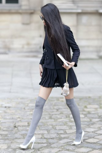 Knee-high socks completed the schoolgirl vibe we got from this peacoat and pleated mini combo.