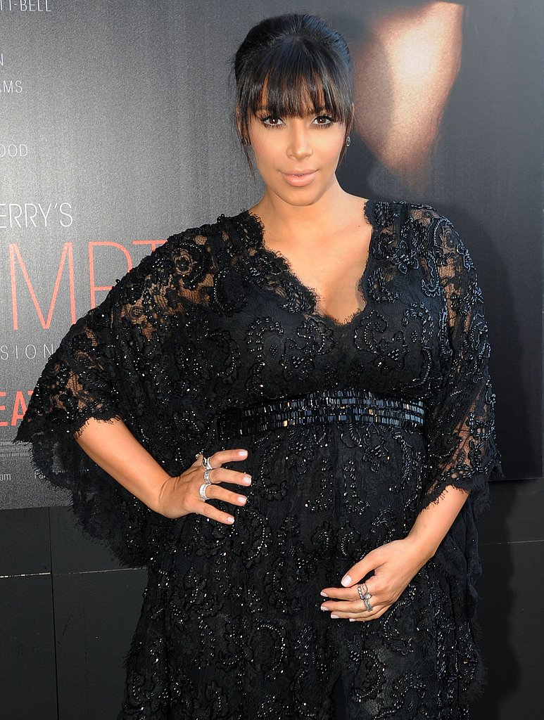 Kim Kardashian wore a black lace ensemble.
