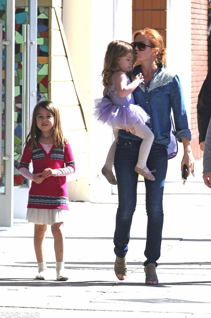Isla Fisher ran errands with her daughters in LA.