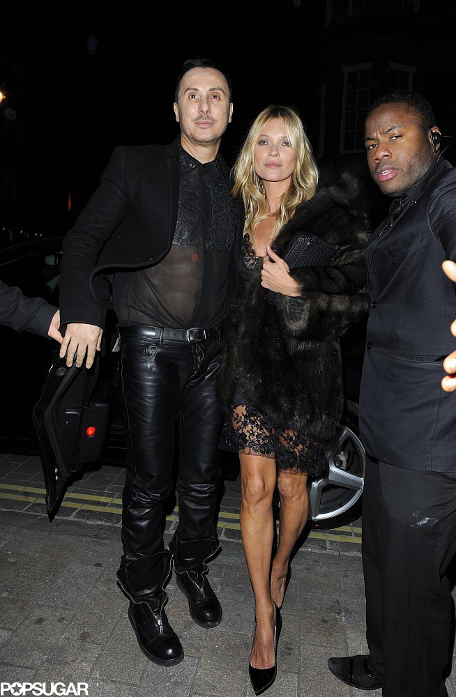 Kate Moss arrived at the launch of hair care brand Kérastase's new Couture Styling Line with friend and stylist Luigi Murenu in London on Monday.