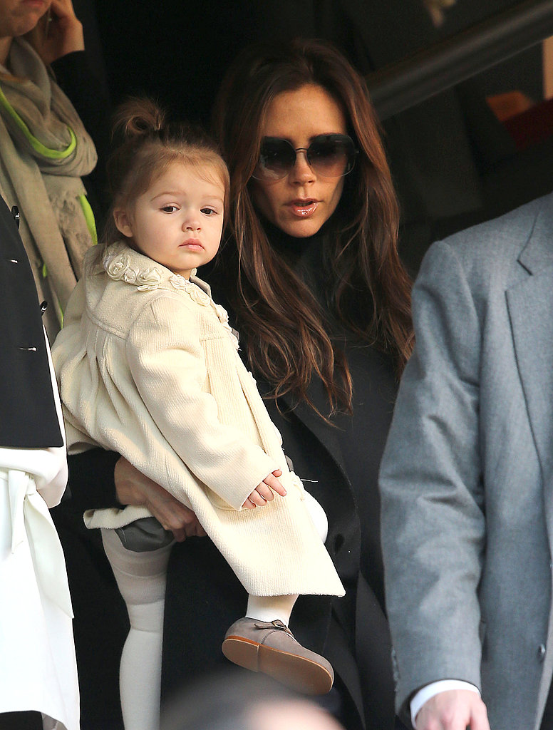 Victoria Beckham held her daughter, Harper, as they ...