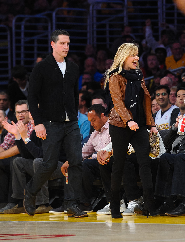 Reese Witherspoon wore a buttery leather jacket with black pants and high-heeled boots for a March 2013 Lakers game.