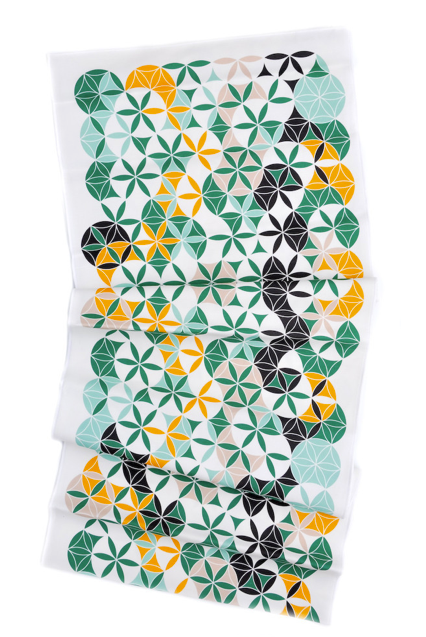 Bring pops of color to the table with this printed table runner ($56); its vibrant green and gold hues are sure to stand out.