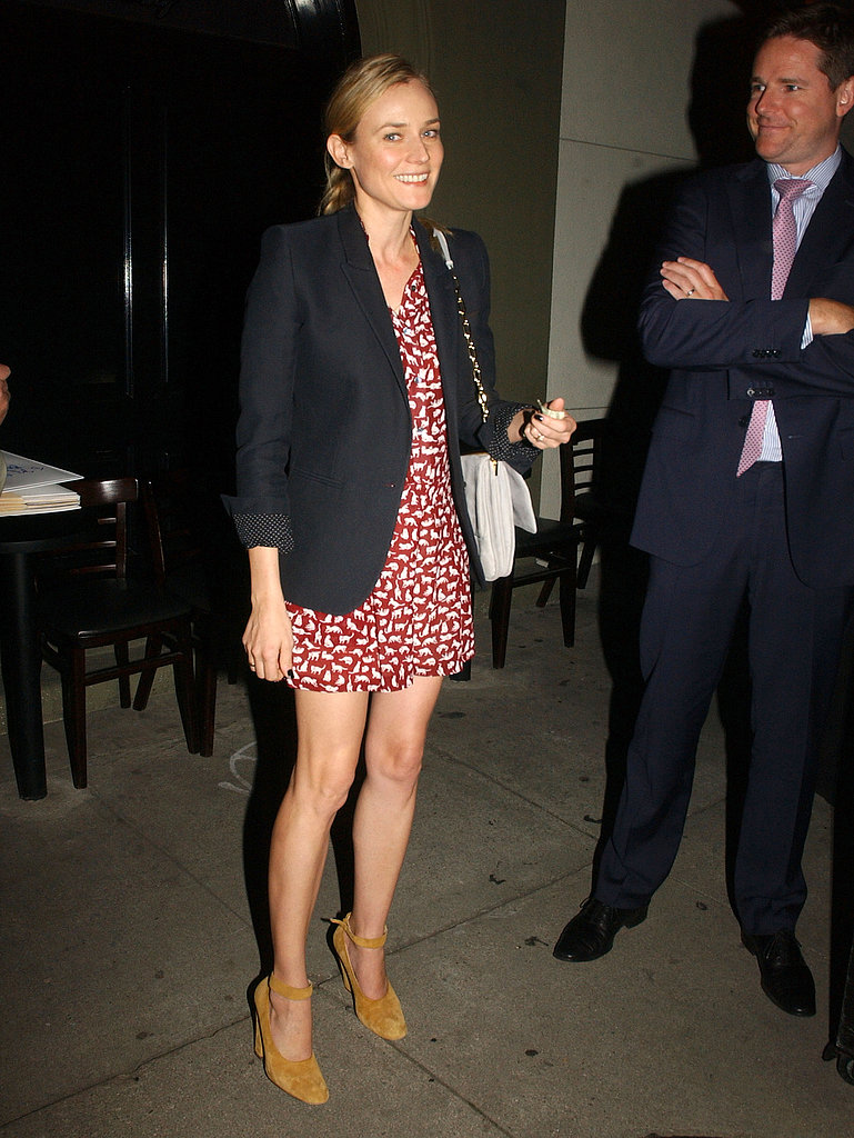 Diane Kruger's Spring style included a printed minidress, a black boyfriend blazer, tan suede ankle-strap pumps, and a light-gray chain-strap bag.