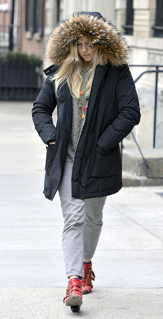 Sienna Miller sported red boots.