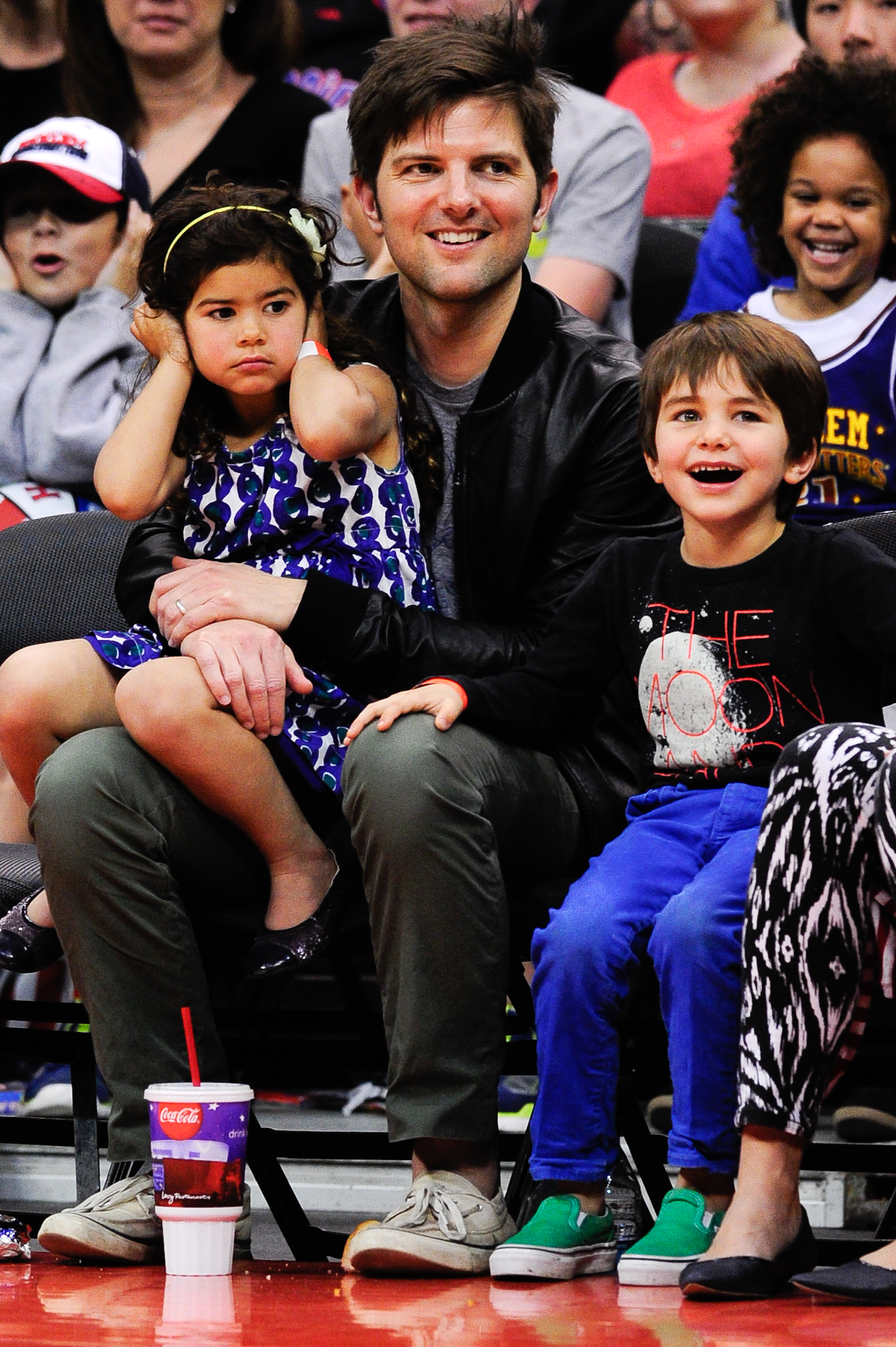 Adam Scott's little girl found the Harlem Globetrotters performance at the Staples Center to be a little overwhelming this past February!