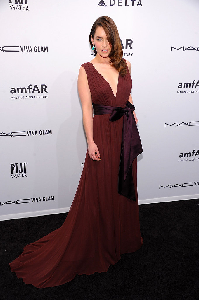 At the amfAR gala in New York in February, Emilia Clarke was every bit the superstar in her deep red plunging Zac Posen gown, which she contrasted with emerald-green earrings.