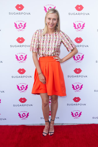 Maria paired up a printed tee with a bold orange skirt, then finished off with the same black sandals at the launch of her candy collection, Sugarpova, in Miami.