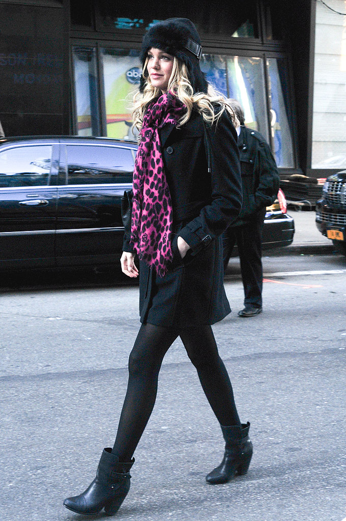 Erin Heatherton went head-to-toe black in NYC, then added a pop of print and color via her vibrant scarf.