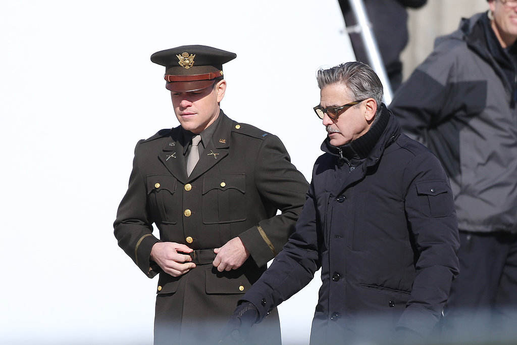 Matt Damon and George Clooney chatted on set while filming The Monuments Men in Berlin.
